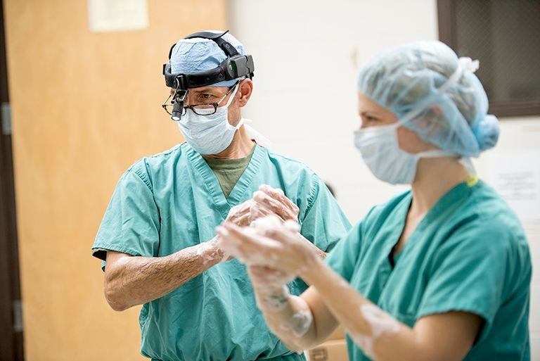 Surgery team members prepare for a procedure