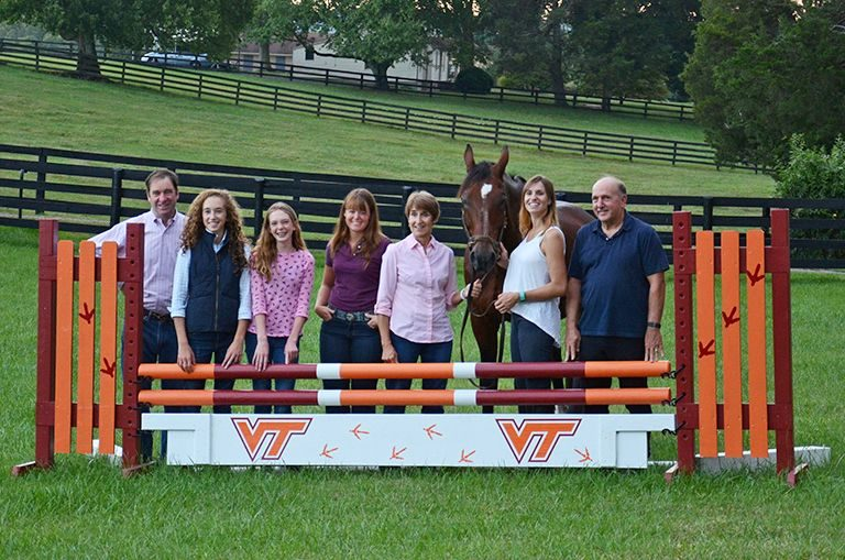 Team Salvador posed behind a VT branded horse jump